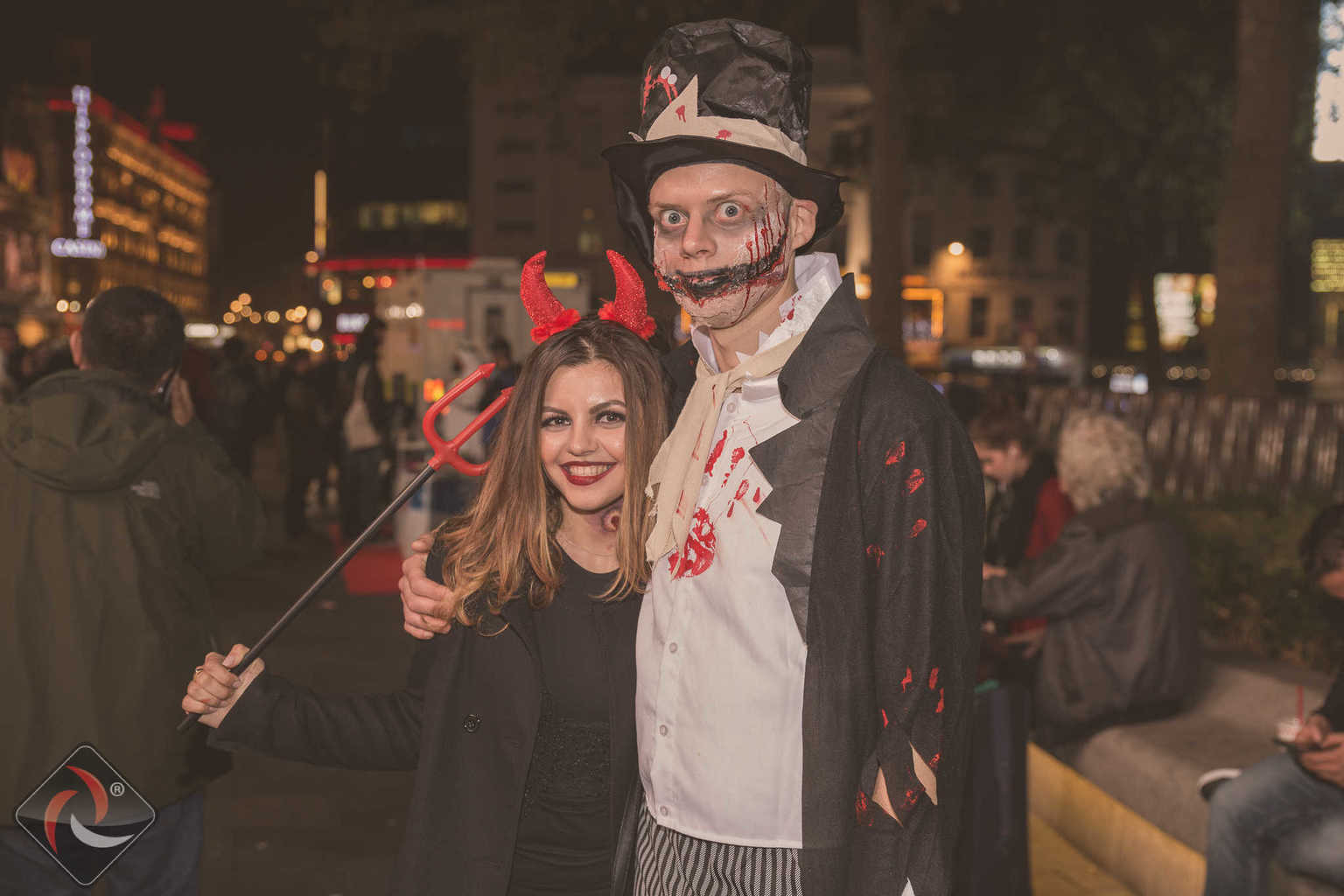 Devil Girl & Man in creepy halloween costume